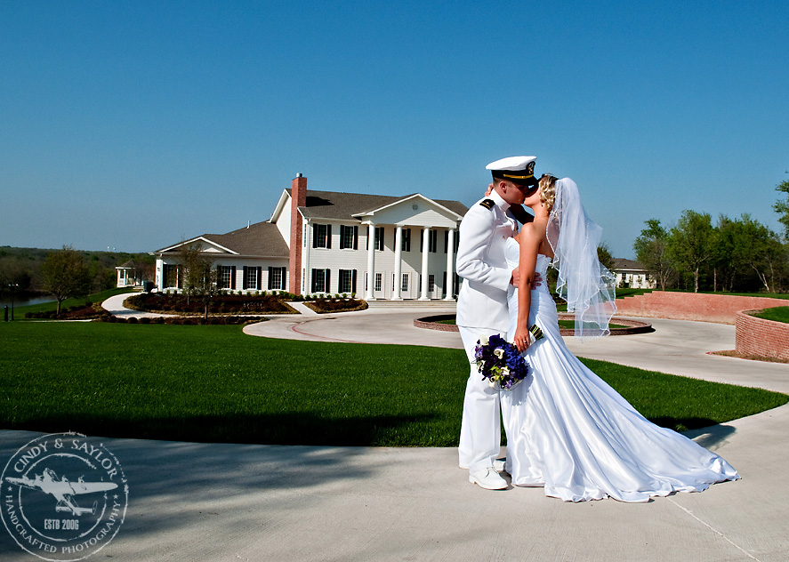 bride and groom in front of the mileston in denton by plano wedding photographers cindy and saylor