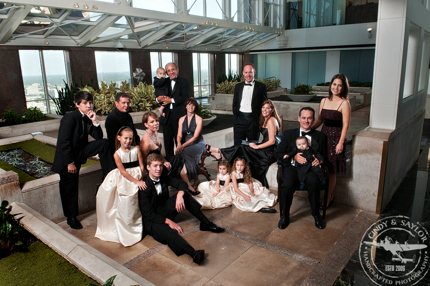 portrait of a large family in formal wear in dallas texas taken at the chase tower in the sky lobby
