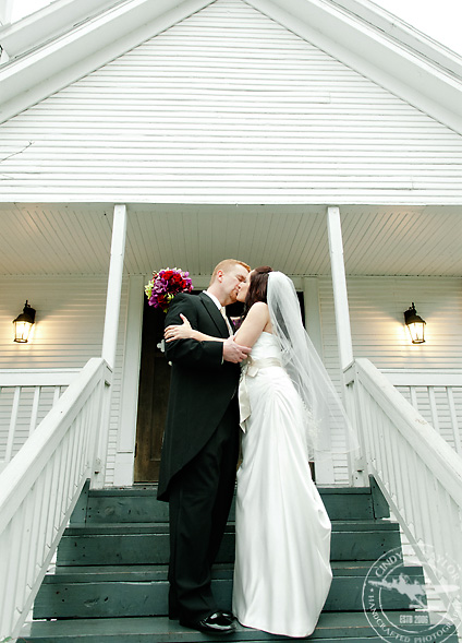 bride and groom portraits in front of a vintage chapel in mckinney at the chapel on chestnut square