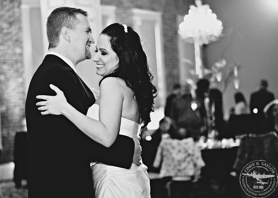 bride and groom's first dance at rick's chophouse ballroom at the grand hotel in mckinney texas