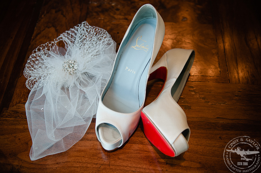 red christian louboutin bride's shoes and veil at gaylord texan wedding in dallas texas
