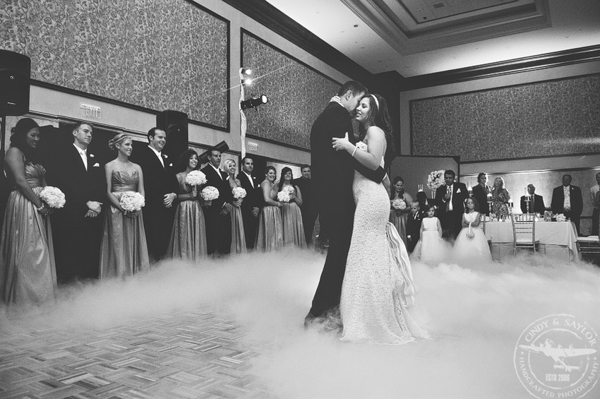 bride and groom first dance with fog on the dance floor