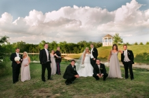 bridal party photo at the milestone in denton with lake and gazebo in the background