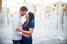 couple in front of fountain downtown ft worth engagement session in sundance square