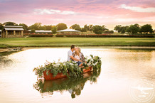 Texas sunset engagement session with canoe filled with flowers arranged by coco fleur
